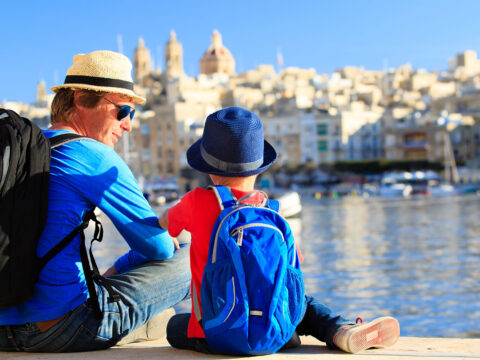 Father and Son on European Vacation; Courtesy of NadyaEugene/Shutterstock.com