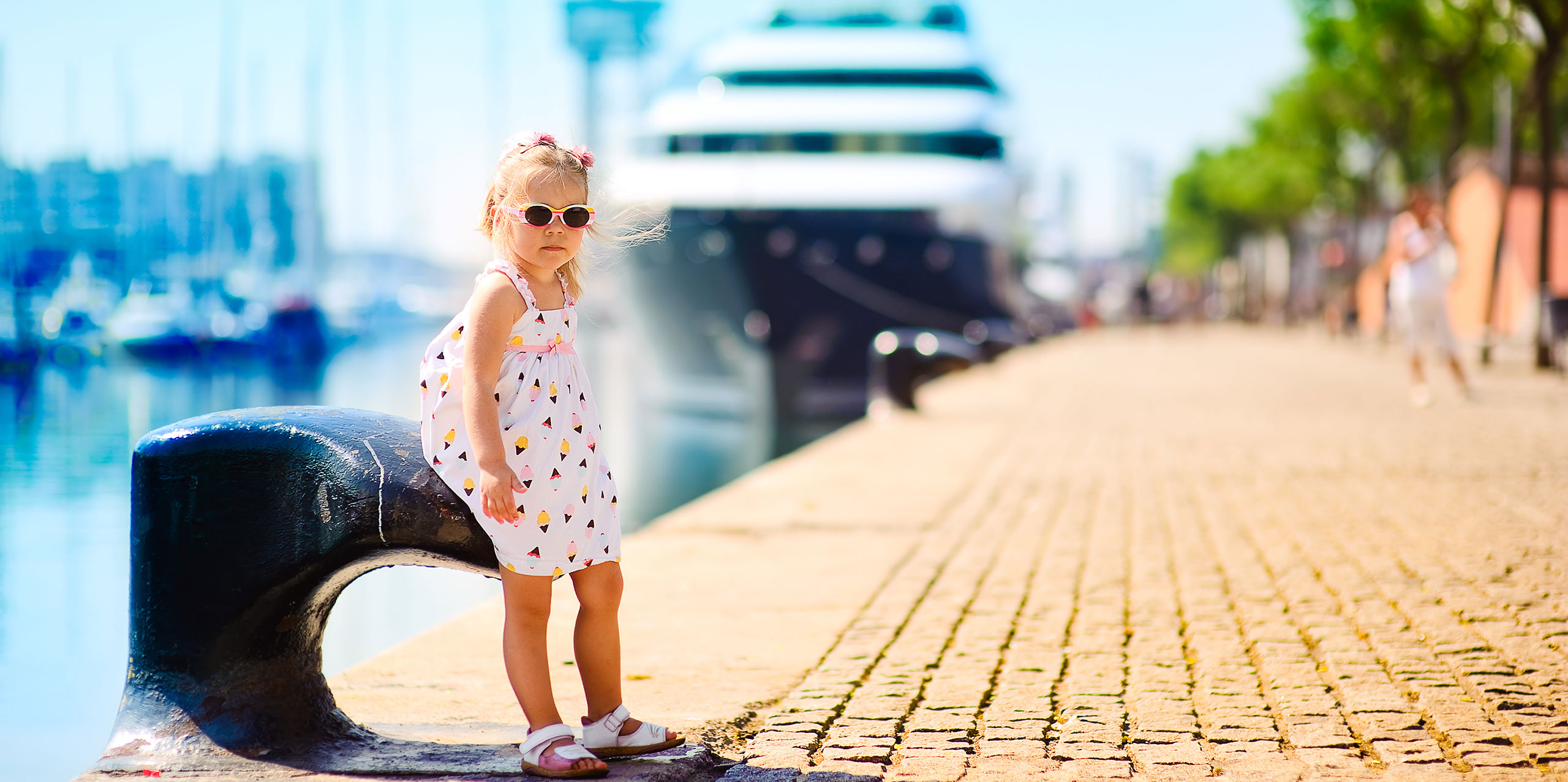 Little Girl in Cruise Port; Courtesy of Natalia Kirichenko/Shutterstock.com
