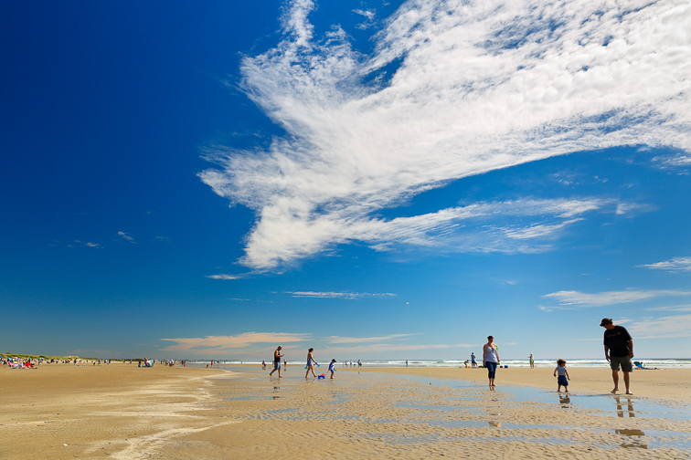 Tourists walking on the Ogunquit Beach, Maine.; Courtesy of Jay Yuan/Shutterstock