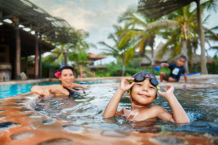 Kids Playing in Pool at Playa Viva in Mexico