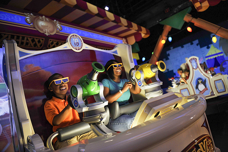 """Guests enjoy the new """"Toy Story Midway Mania!"""" attraction at Disney's Hollywood Studios in Lake Buena Vista, Fla.; Courtesy of Walt Disney World"""