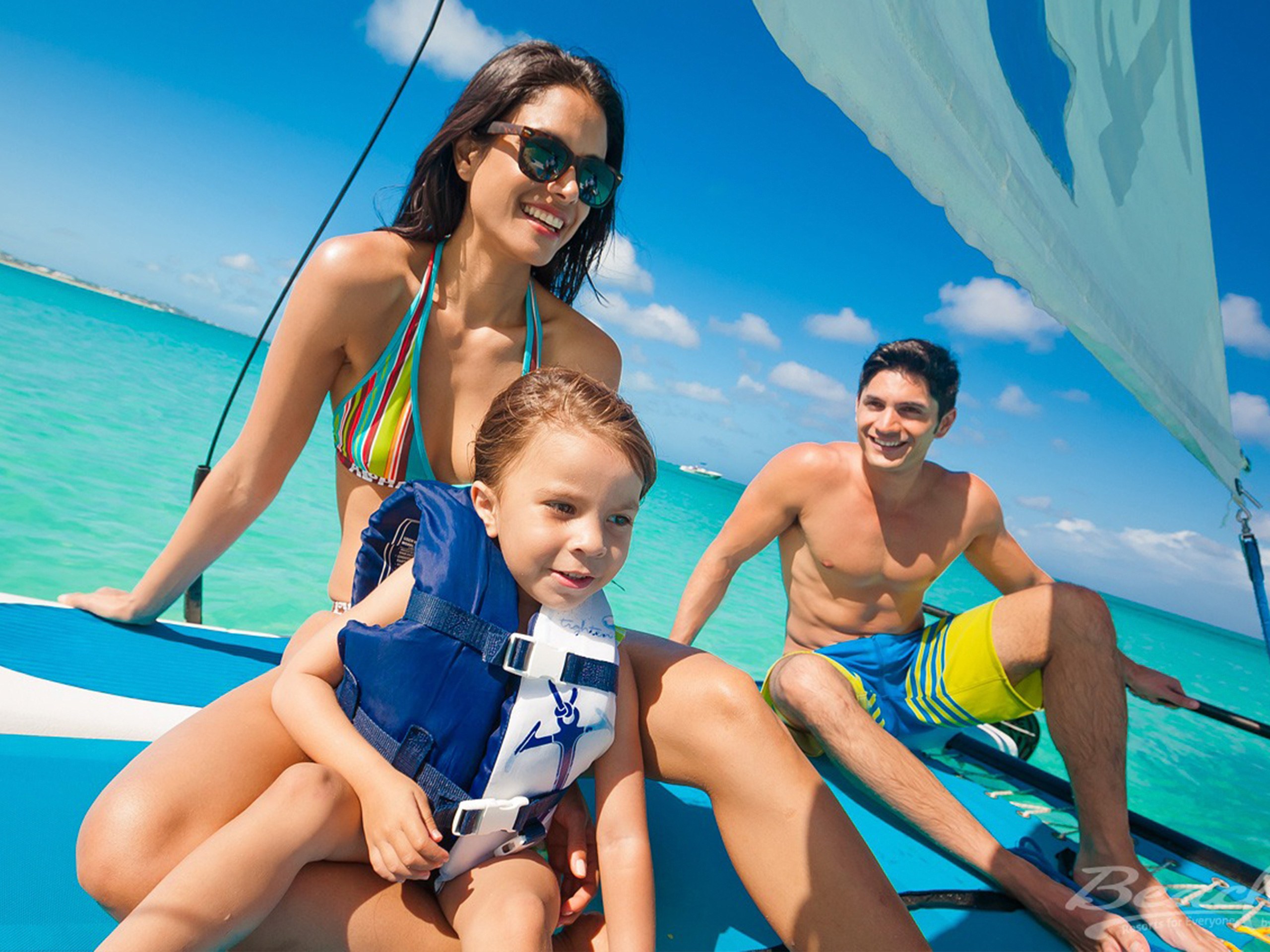 beaches resort mom dad toddler sailboat; Courtesy of Beaches Turks & Caicos