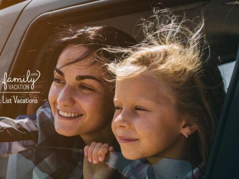 Happy family on a road trip in their car.; Courtesy of Estrada Anton/Shuttertsock