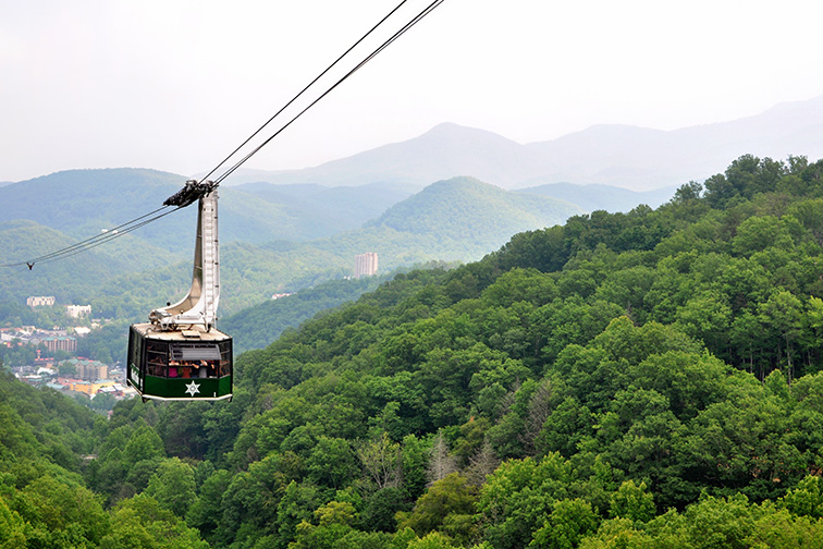Tourists riding the scenic gondola cable car at Ober Gatlinburg in Tennessee; Courtesy of David Carillet/Shutterstock