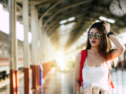 carrying backpacks are having trouble traveling and adventurous at the train station; Courtesy of Miss Nuchwara Tongrit/ Shutterstock