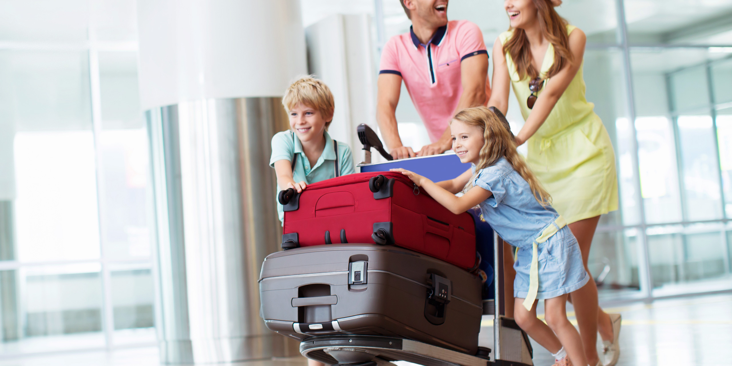 Family wheeling large suitcases in airport; Courtesy of AboutLife/Shutterstock