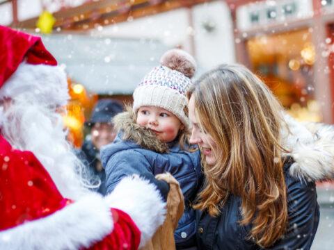 toddler mom christmas market santa; Courtesy of Romrodphoto /Shutterstock