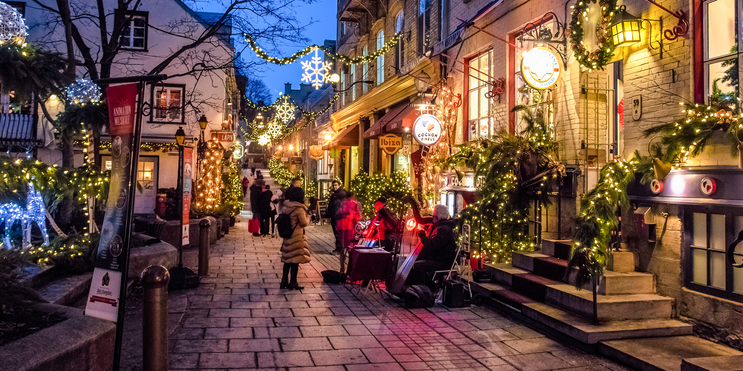 quebec city montreal holiday street; Courtesy of By AnjelikaGr/Shutterstock