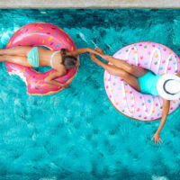 Mom and Daughter in Pool; Courtesy of Alena Ozerova/Shutterstock.com