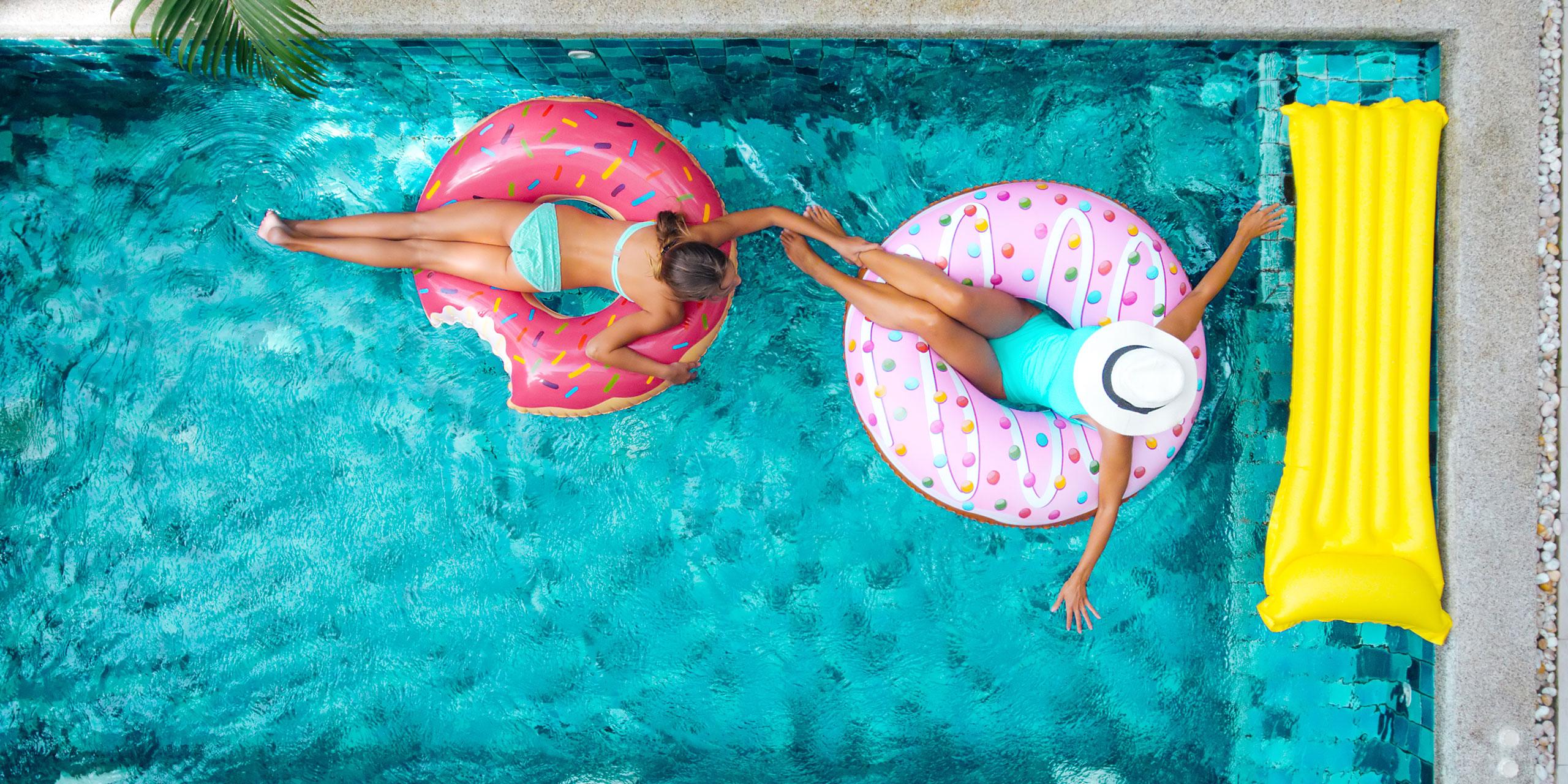 Mom and Daughter in Pool; Courtesy of Alena Ozerova/Shutterstock.com