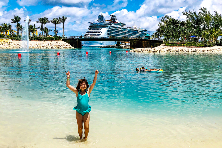 little girl standing in front of cruise ship in port; Courtesy of Cortney Fries