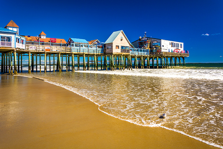 The Atlantic Ocean and pier in Old Orchard Beach, Maine.; Courtesy of Jon Bilous/Shutterstock