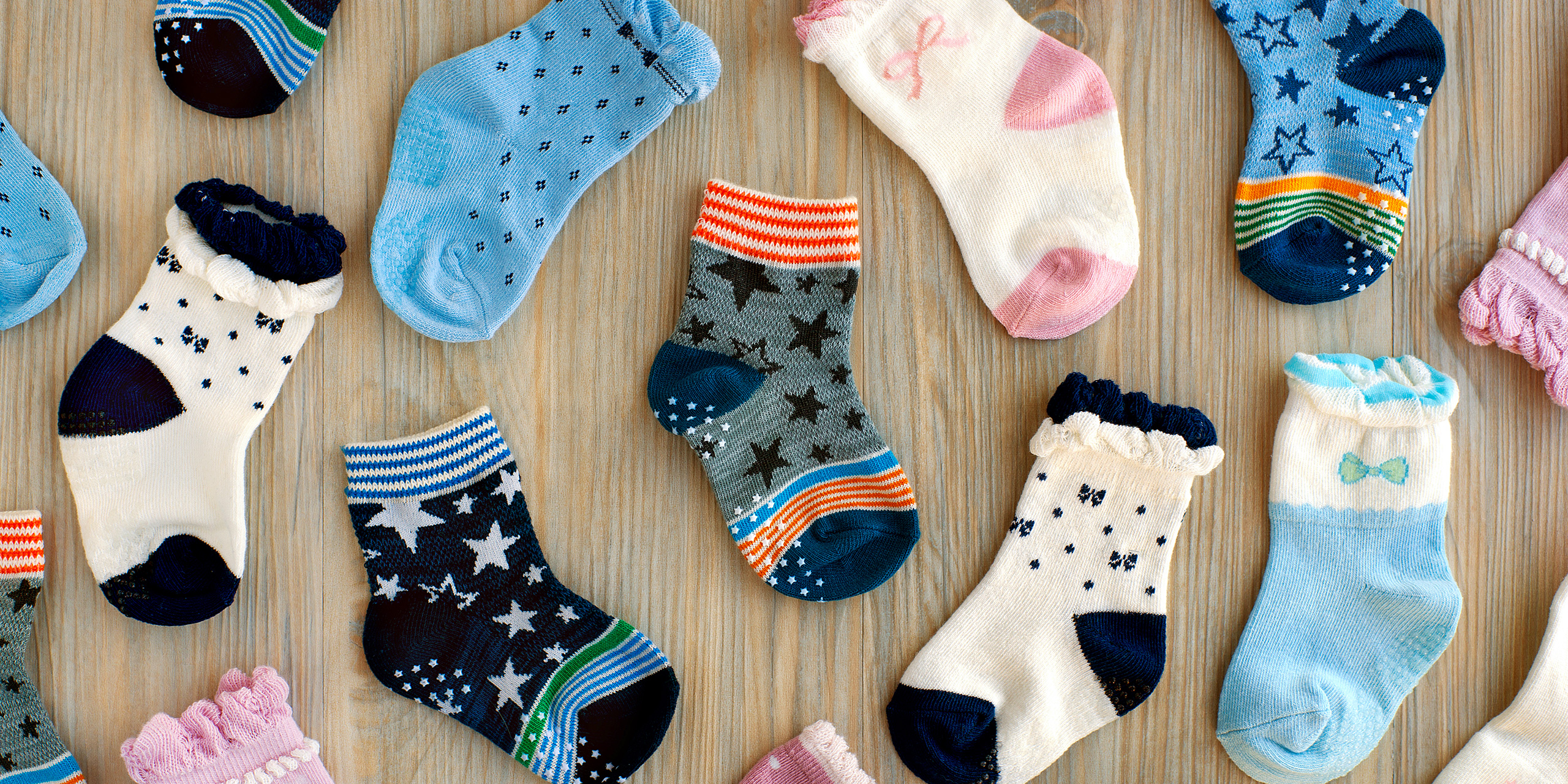 baby socks flat lay on a table top; Courtesy of Evgeniya369/Shutterstock