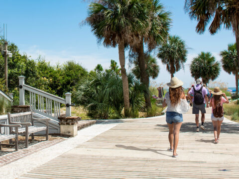 Family walking to the beach on summer vacation; Courtesy of margaret.wiktor/Shutterstock