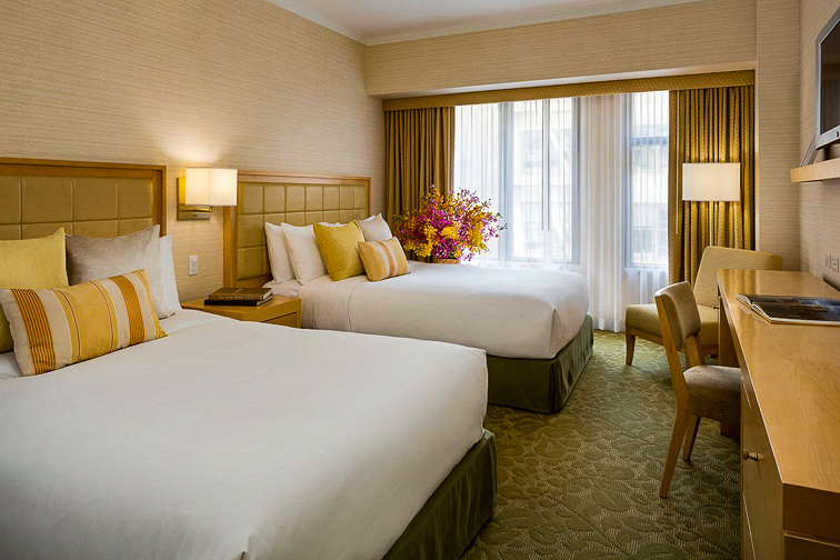 The Orchard Garden Hotel guest room; Courtesy of The Orchard Garden Hotel