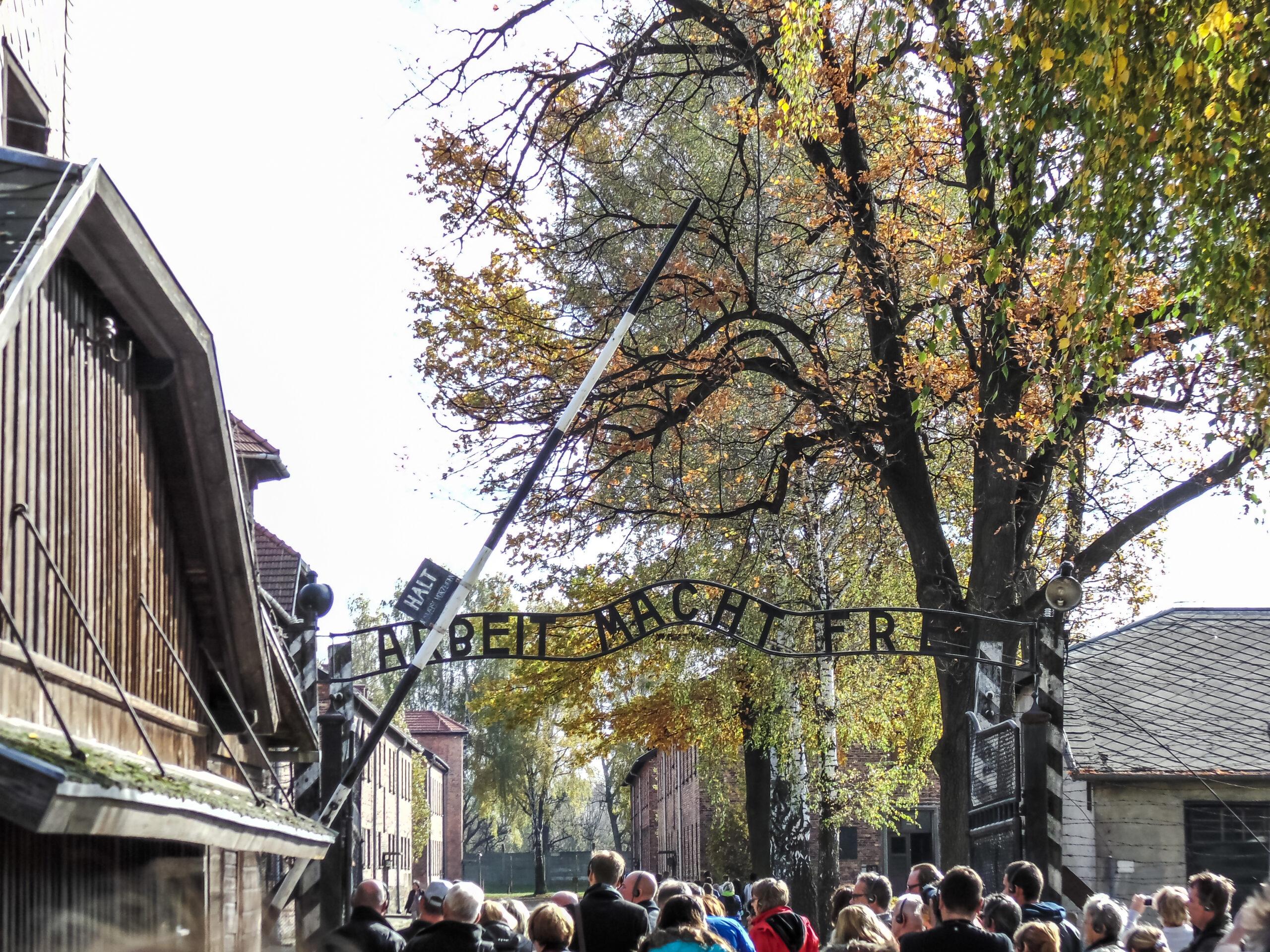 Auschwitz entrance gate with tourists; Courtesy Thomas Ortega/Shutterstock