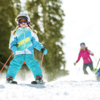 Kids skiing at Keystone Resort in Colorado; Courtesy of Vail Resorts/Daniel Milchev