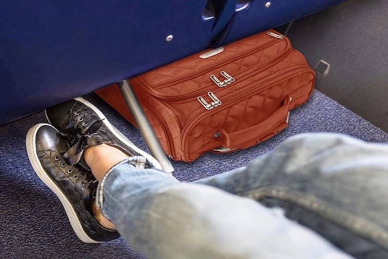 Suitcase under airplane seat