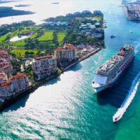 Cruise ship enter to Atlantic ocean from Government Cut canal. ; Courtesy Mia2You/Shutterstock