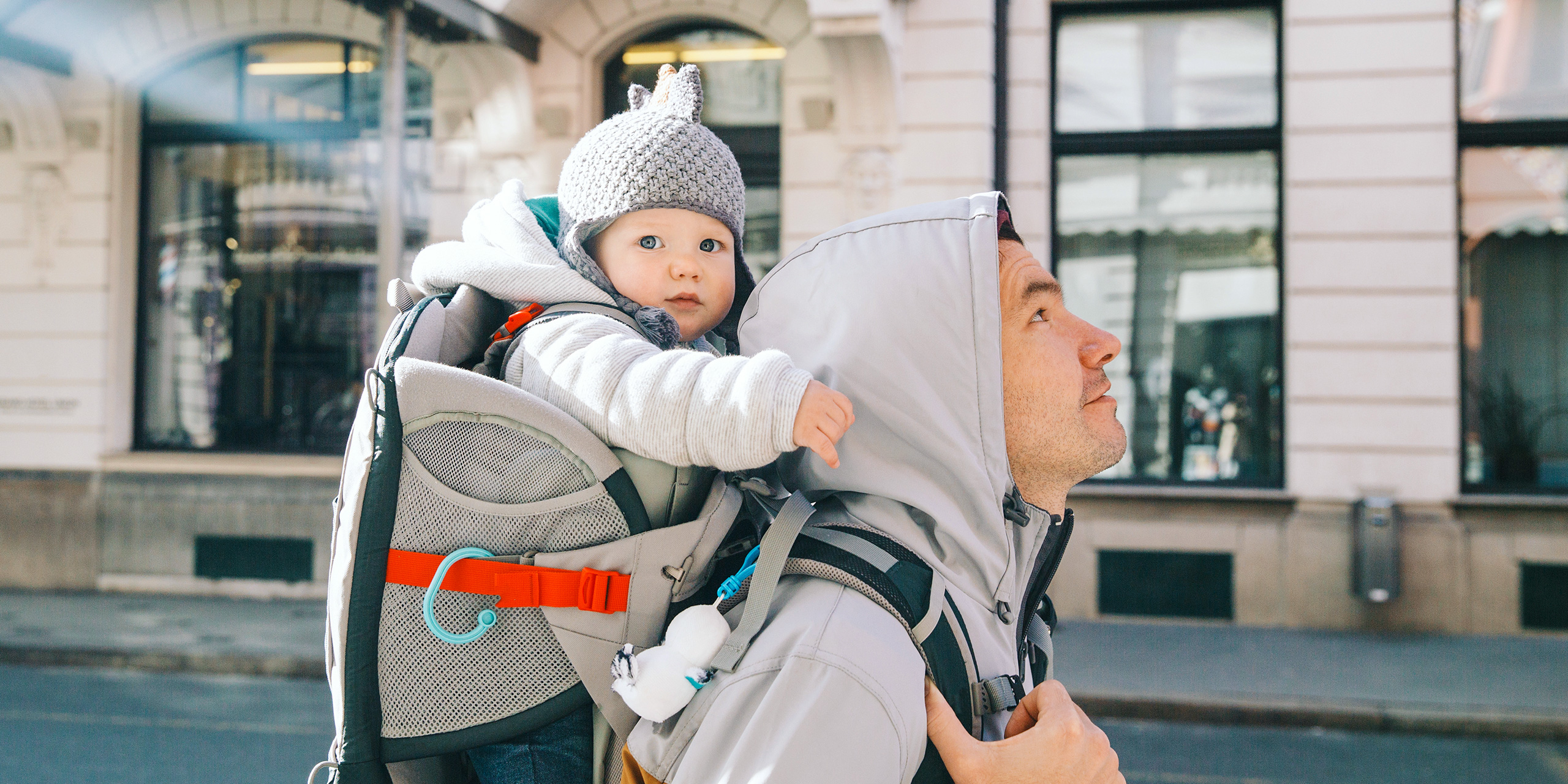 dad walking with a baby in a carrier backpack; Courtesy Natalia Deriabina/Shutterstock