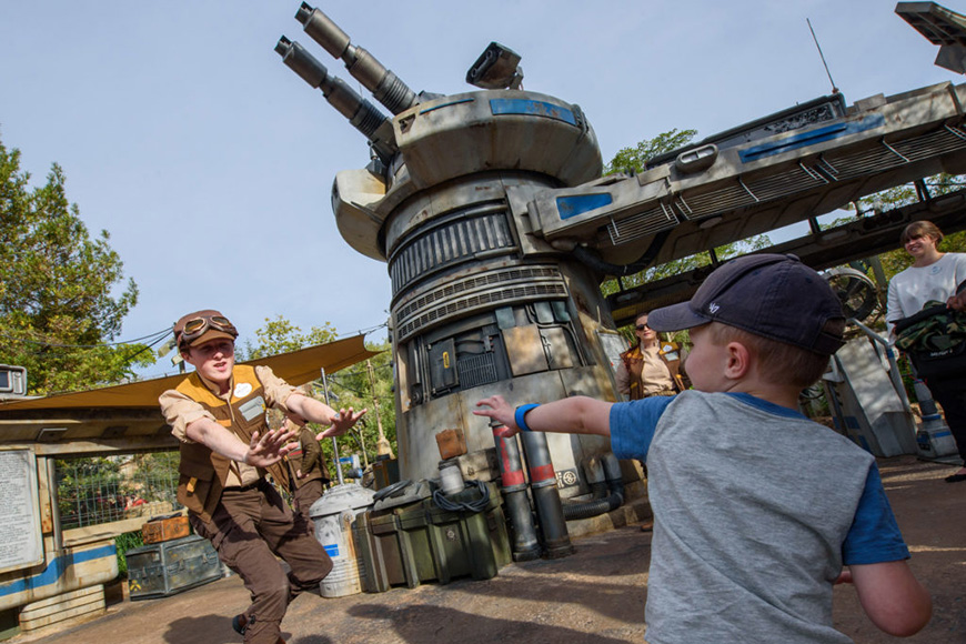 A child interacts with a Disney's Hollywood Studios cast member at the entrance to Star Wars: ; Courtesy Disney