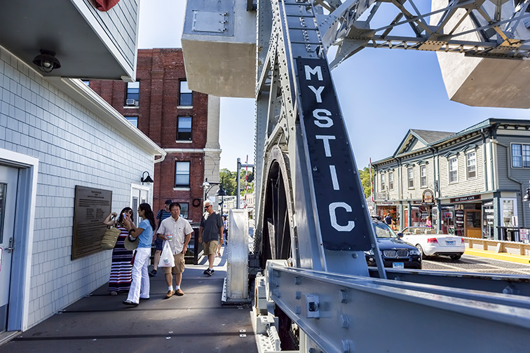 The Mystic bascule bridge spans the Mystic river, it carries foot traffic to the tourist district of town.; Courtesy Paul Latham/Shutteerstock