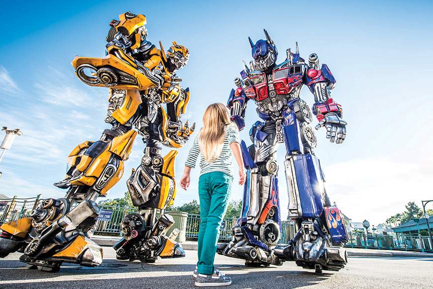 Optimus Prime, leader of the Autobots, and Bumblebee make in-park appearances at Universal Studios Florida.; Courtesy Universal Studios