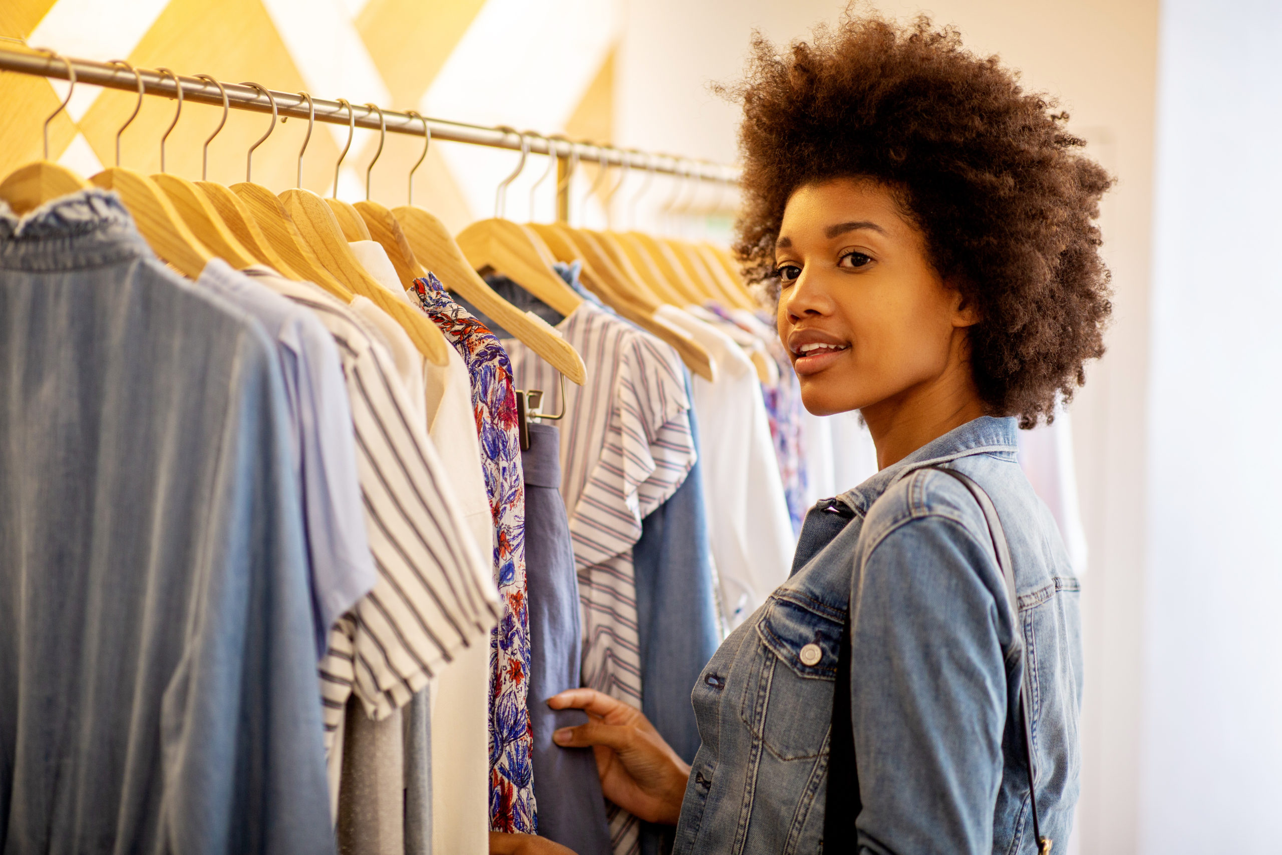 Woman shopping for clothes at clothes rack