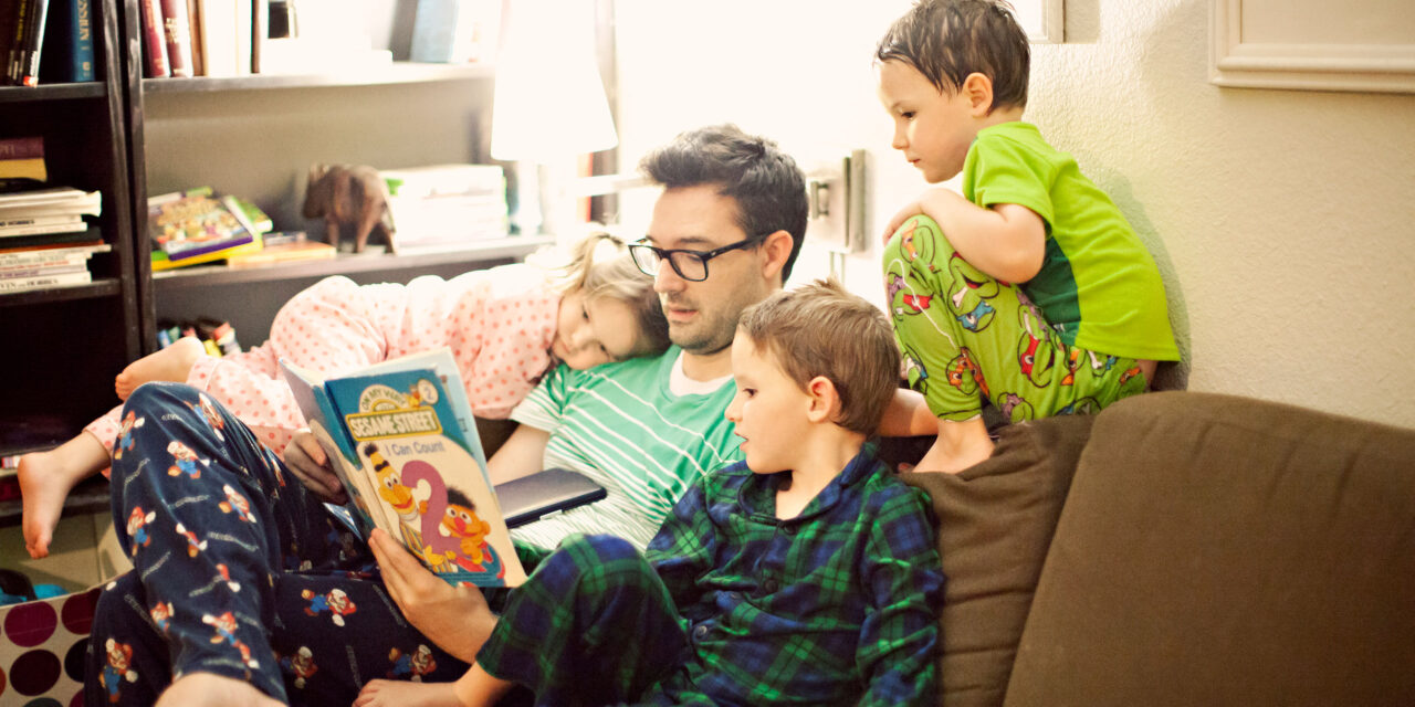 Dad Reading Bedtime Stories to Kids