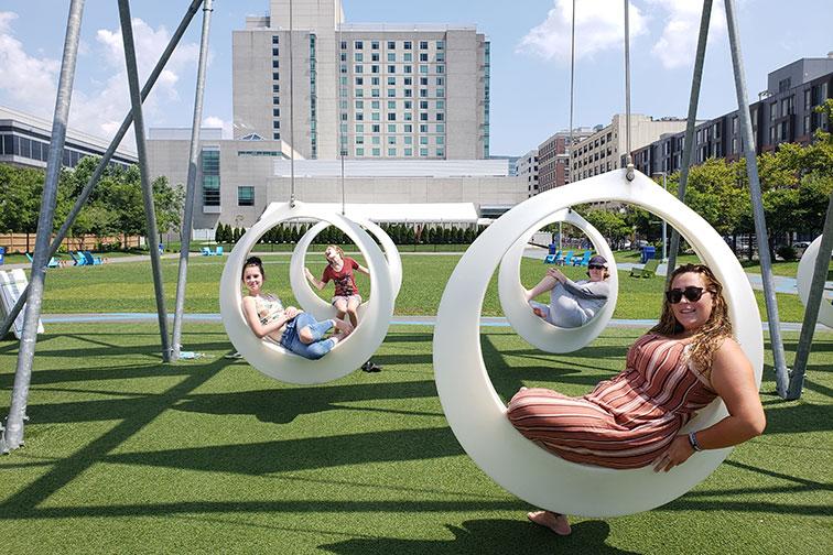Girls on Swings in Boston; Courtesy of Jeff Bogle