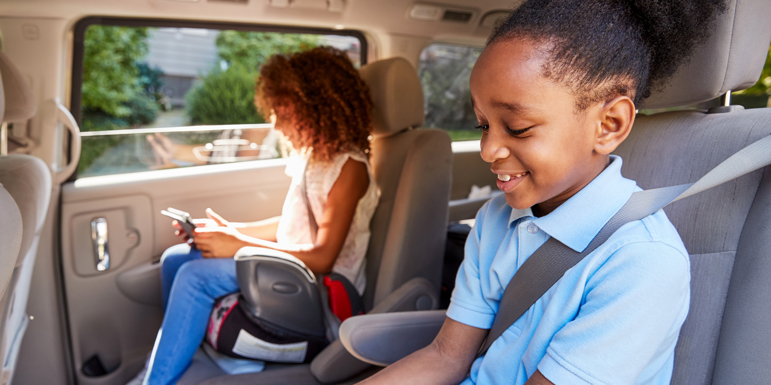 children in car using booster seat