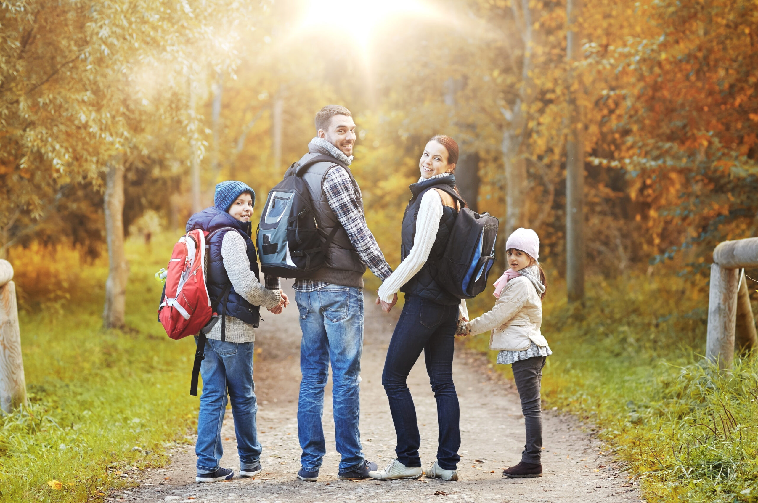 Family hiking in fall.
