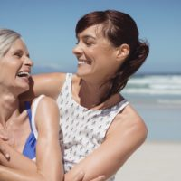 Woman with daughter on beach