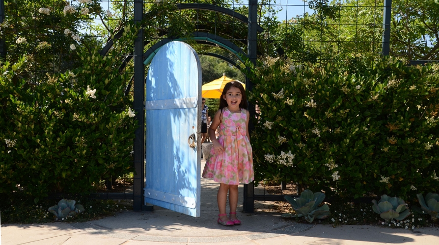 Child walking through door at the The Huntington Library, Art Museum, and Botanical Gardens
