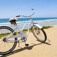 Bike in front of entrance to beach with ocean in background