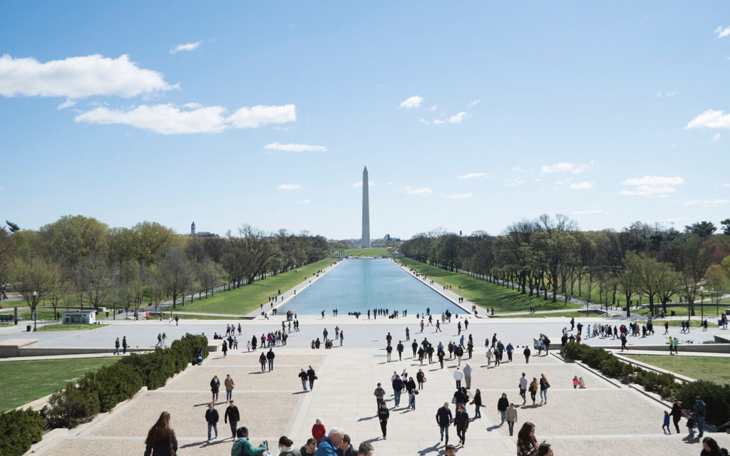 People walking in the plaza in front of the Washington Monument