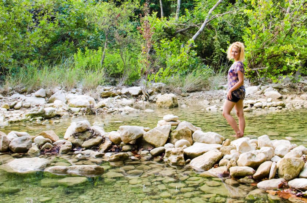 Woman standing in Barton Creek Greenbelt in Austin, Texas