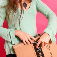 Woman opening Amazon Prime package