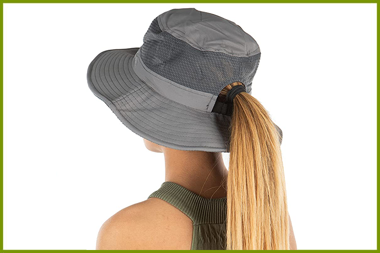 Woman with ponytail wearing a bucket hat