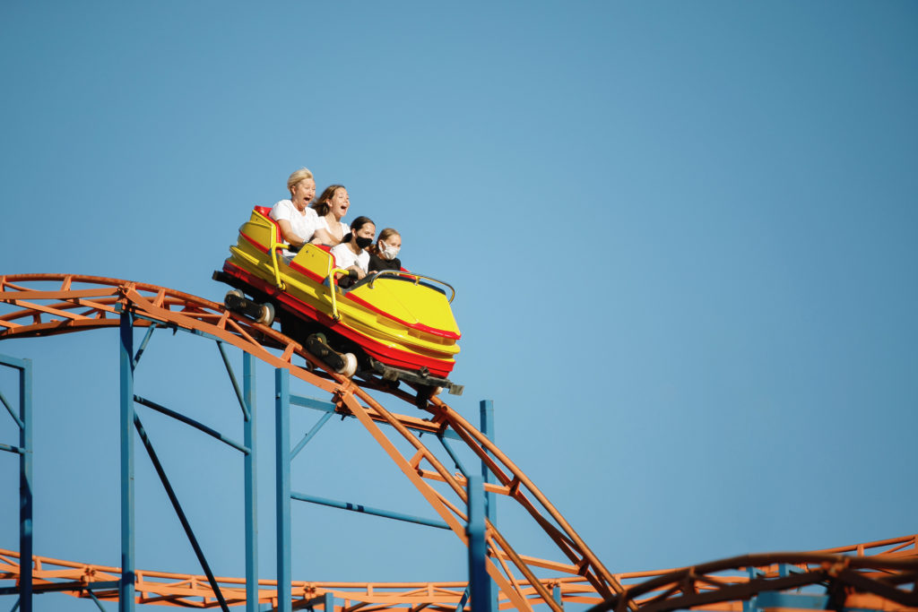 Four people riding a roller coaster