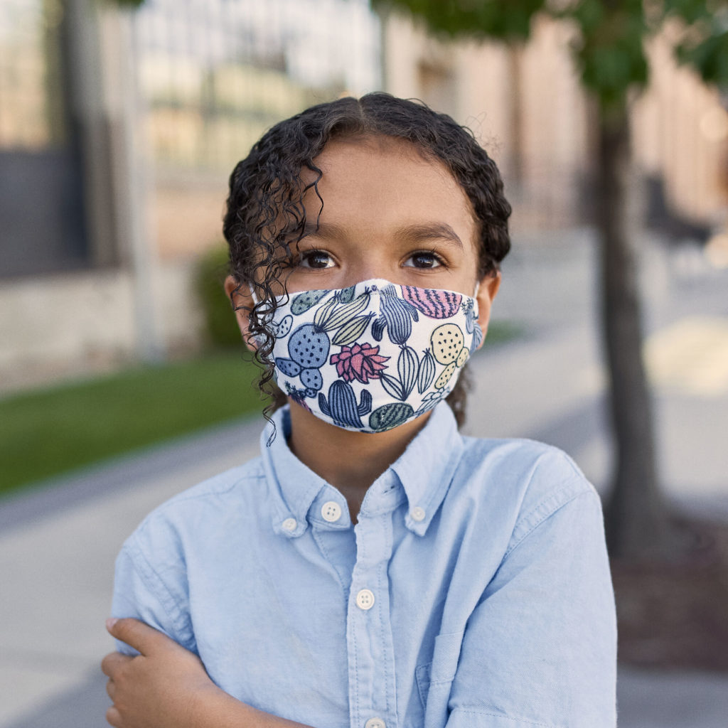 Honest Young girl wearing Honest Company Kids Cotton Face Masks