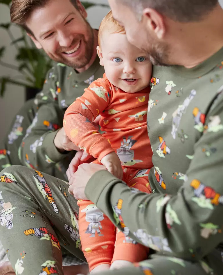 Two men and baby wearing Hanna Anderson Star Wars Halloween Matching Family Pajamas