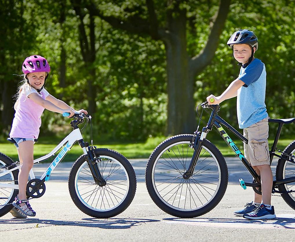 Two kids riding Trek bikes
