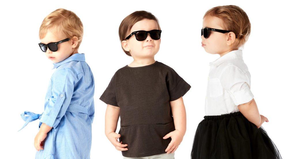Three toddlers wearing WeeFarer sunglasses